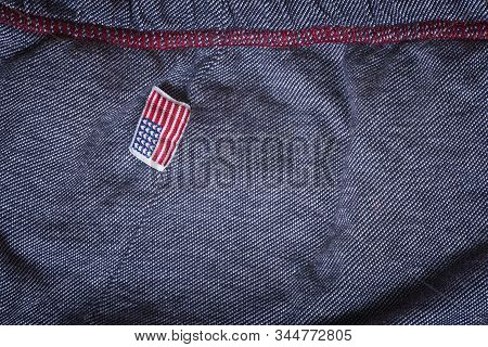Buy American. USA flag clothing label. Buy American-made goods concept. stock photo