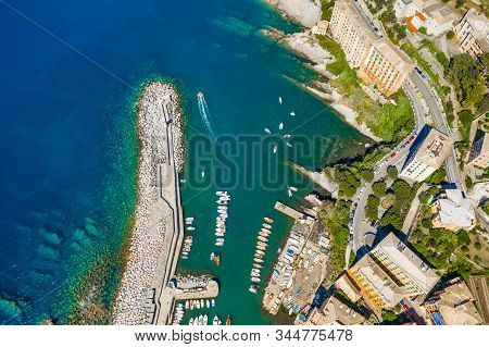 Camogli Harbor aerial view. Colorful buildings, boats and yachts moored in marina with green water. stock photo