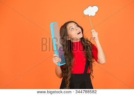 Communication. Tangled hair. Inspiration creating hairstyle. Idea for hair. Get rid of annoying tangles. Girl long hair hold comb and speech bubble. Hairdresser salon. Combing hair. Styling tips. stock photo