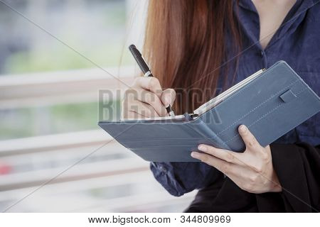 Agenda of planner woman schedule and organize appointment 2019 Calendar Event. Smart Business woman note and schedule to set timetable organize schedule. Woman hands writing on Agenda.Timeline concept stock photo