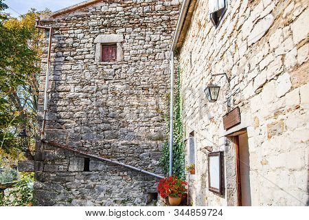 Town of Hum, beautiful old stone traditional architecture in Istria, Croatia, countryside landscape stock photo