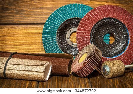 Big set of abrasive tools and sandpaper on vintage wooden boards wizard is used for grinding items stock photo