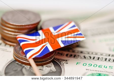 England flag with coins on dollar banknotes background :  Banking Account, Investment Analytic research data economy, trading, Business company concept. stock photo