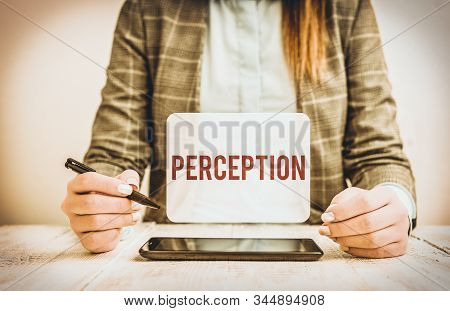 Text sign showing Perception. Conceptual photo individuals organize and interpret their sensory impressions Business woman sitting with mobile phone and pen in the hand. stock photo