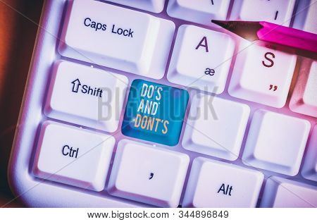 Handwriting text Do S And Don tS. Concept meaning Rules or customs concerning some activity or actions White pc keyboard with empty note paper above white background key copy space. stock photo