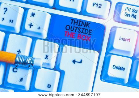 Writing note showing Think Outside The Box. Business photo showcasing Be unique different ideas bring brainstorming White pc keyboard with note paper above the white background. stock photo