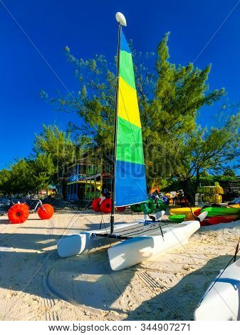 Colorful sailboats and motorboat, on a tropical beach at Half Moon Cay in the Bahamas on a tropical beach at Half Moon Cay in the Bahamas stock photo