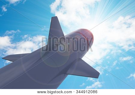 Military strategic missile is aimed at the blue sunny sky. Tactical missile at the start. 3D rendering, illustration. stock photo
