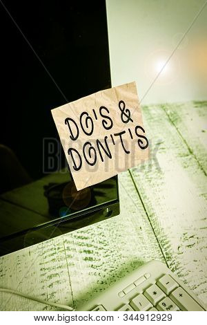 Conceptual hand writing showing Do S And Don T S. Business photo text Confusion in one s is mind about something Notation paper computer monitor screen near white keyboard. stock photo