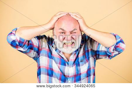Age issues. Health care concept. Male pattern baldness genetic condition caused by variety factors. Early signs balding. Elderly people. Bearded grandfather grey hair. Hair loss. Man losing hair stock photo