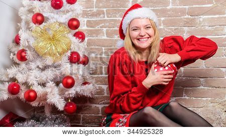 Definitely like it. Woman excited opening gift from santa claus. Christmas eve excitement. Open christmas box. Girl emotional excited face hold christmas gift. Wish list. All i want for christmas stock photo