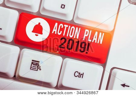 Text sign showing Action Plan 2019. Conceptual photo proposed strategy or course of actions for current year White pc keyboard with empty note paper above white background key copy space. stock photo