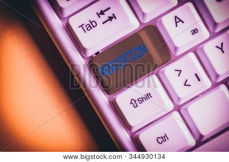 Handwriting text Perception. Concept meaning individuals organize and interpret their sensory impressions White pc keyboard with empty note paper above white background key copy space. stock photo