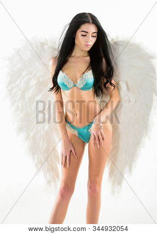 Girl wear lingerie and angel wings accessory.Desirable and tempting lady. Purity and innocence. Delicate sensual woman posing with angel wings. Fashion model stock photo