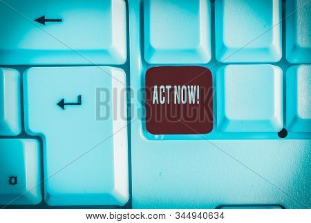 Word writing text Act Now. Business concept for fulfil the function or serve the purpose of Take action Do something White pc keyboard with empty note paper above white background key copy space. stock photo