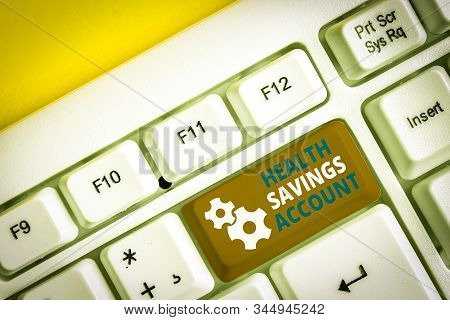 Handwriting text writing Health Savings Account. Concept meaning users with High Deductible Health Insurance Policy White pc keyboard with empty note paper above white background key copy space. stock photo