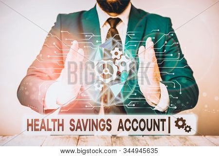 Text sign showing Health Savings Account. Conceptual photo users with High Deductible Health Insurance Policy Male human wear formal work suit presenting presentation using smart device. stock photo