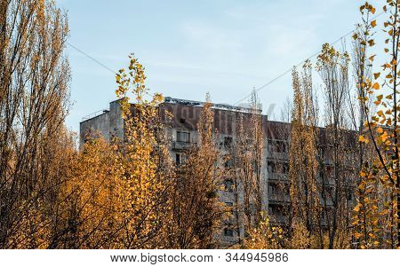 old empty big house on the street of the abandoned city Chernobyl Ukraine in autumn stock photo