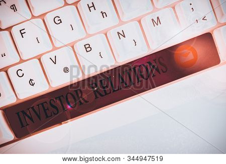 Text sign showing Investor Relations. Conceptual photo analysisagement responsibility that integrates finance White pc keyboard with empty note paper above white background key copy space. stock photo