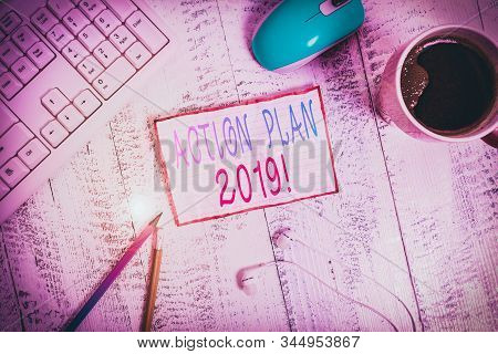 Handwriting text Action Plan 2019. Concept meaning proposed strategy or course of actions for current year technological devices colored reminder paper office supplies keyboard mouse. stock photo