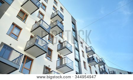 Contemporary residential building exterior in the daylight. Modern apartment buildings on a sunny day with a blue sky. Facade of a modern apartment building stock photo