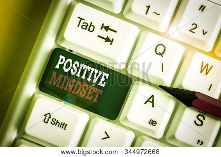 Writing note showing Positive Mindset. Business photo showcasing mental attitude in wich you expect favorable results White pc keyboard with note paper above the white background. stock photo