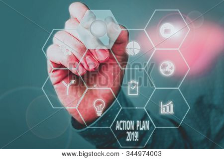 Handwriting text Action Plan 2019. Concept meaning proposed strategy or course of actions for current year Picture photo system network scheme modern technology smart device. stock photo