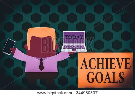 Word writing text Achieve Goals. Business concept for Results oriented Reach Target Effective Planning Succeed Standing professional man tie holding left open laptop right mobile phone. stock photo