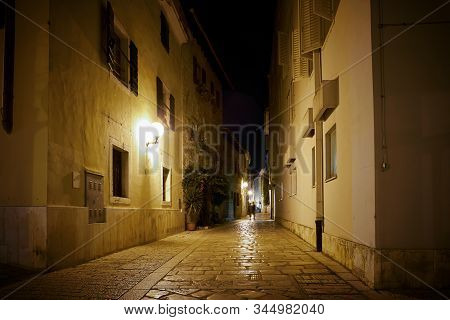 Alley in the historical old town of Porec in Croatia in the late evening stock photo