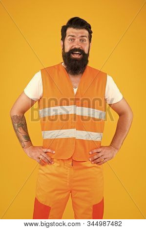 Safety apparel for construction industry. Bearded brutal hipster safety engineer. High visibility reflective safety vest. Man worker protective uniform orange background. Safety equipment concept. stock photo