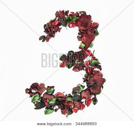 Latin alphabet number made from dry rose flowers. stock photo