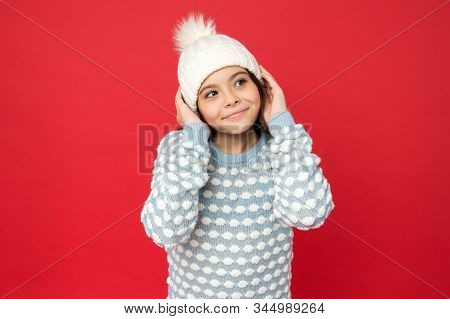 Adorable baby. Angel child. Child in cosy knitted outfit. Winter fashion. Childhood happiness. Winter activity. Positive concept. Good mood. Emotional wellbeing. Emotions concept. Girl enjoy winter. stock photo