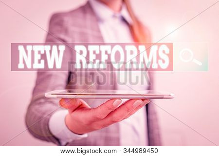 Writing note showing New Reforms. Business photo showcasing to amend or improve by change of form or removal of faults Business concept with mobile phone and business woman. stock photo