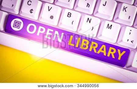 Handwriting text Open Library. Concept meaning online access to analysisy public domain and outofprint books White pc keyboard with empty note paper above white background key copy space. stock photo