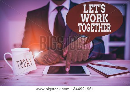 Handwriting text writing Let S Work Together. Concept meaning Unite and Join Forces to Achieve a Common Goal Male human wear formal clothes present presentation use hi tech smartphone. stock photo