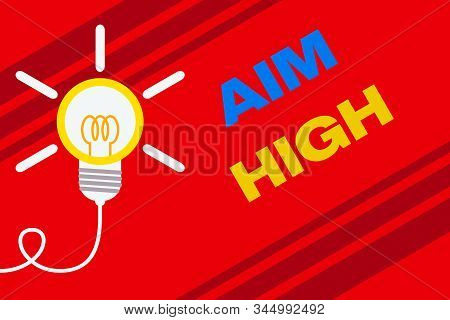 Conceptual hand writing showing Aim High. Business photo text go for best job school or activity Asking someone to dream big Idea light bulb Successful turning idea invention Startup. stock photo