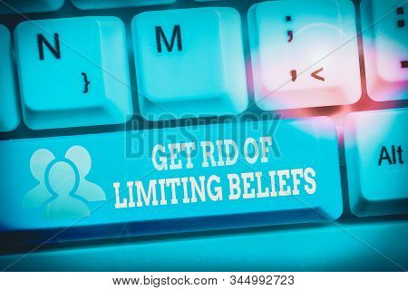 Conceptual hand writing showing Get Rid Of Limiting Beliefs. Business photo text remove negative beliefs and think positively Keyboard with note paper on white background key copy space. stock photo