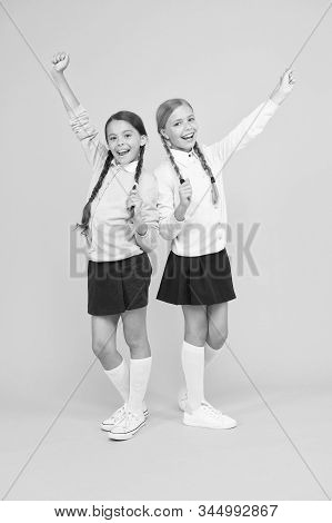 Friendly relationship. Friendship goals. Cute school girls classmates. My dear friend. First school day. Sisterhood and friendship. Cheerful mood concept. School friendship. Support and friendship. stock photo