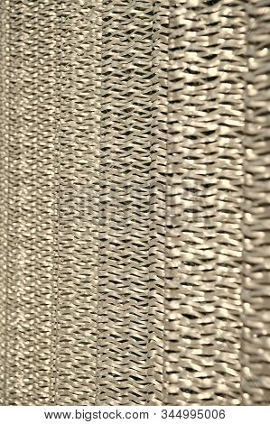 Metallic netting, Protective material. Metal recycling. Metallic screen. Industrial concept Iron producing. Sharp metallic texture. Silver foil background Metal surface lathing. stock photo