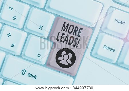 Conceptual hand writing showing More Leads. Business photo text initiation of consumer interest or enquiry into product White pc keyboard with note paper above the white background. stock photo