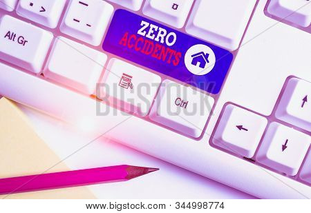 Handwriting text Zero Accidents. Concept meaning important strategy for preventing workplace accidents White pc keyboard with empty note paper above white background key copy space. stock photo