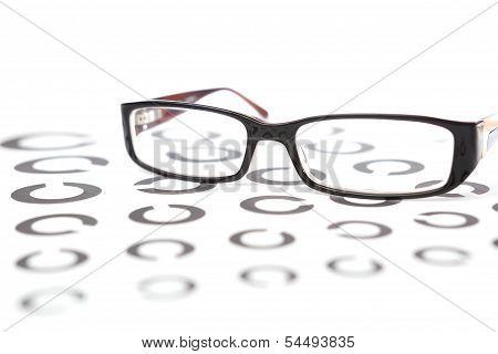 Glasses on eye test with landolt rings stock photo
