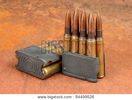 World War II M1  Clips and 30-06 ammunition on rusty background. stock photo