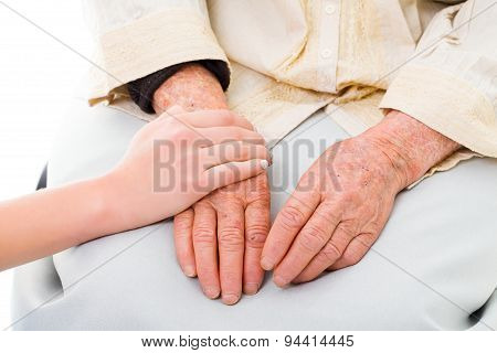 Supporting hands for sick and weak senior woman. stock photo