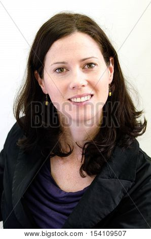 Portrait of a happy young business woman against white background. stock photo
