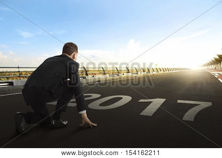 Asian Businessman With 2017 Numbers As Starting Line