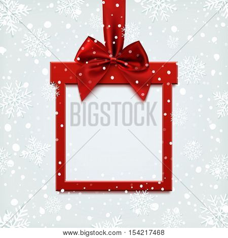 Blank red square banner in form of Christmas gift with red ribbon and bow, on winter background with snow and snowflakes. Brochure or banner template.