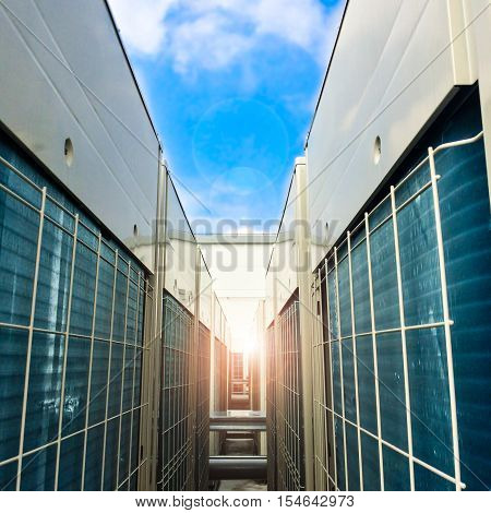 Condenser unit used in central air conditioning systems - heat exchanger (heat micro canel) section to cool down and condensate incoming refrigerant vapor into liquid. background texture. Air conditioner technology. stock photo