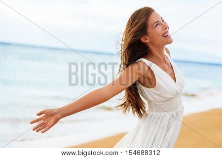 Free happy woman on beach enjoying nature. Natural beauty girl outdoor in freedom enjoyment concept.