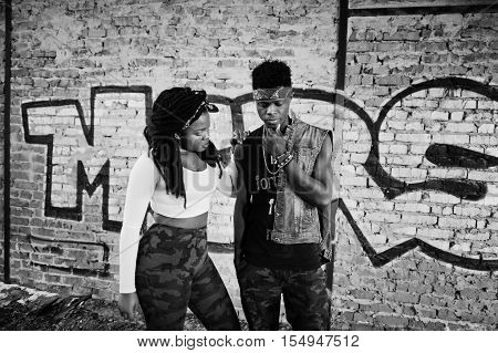 Couple of hip-hop afroamerican on undergraund. Black and white photo stock photo
